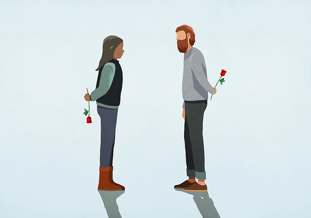 Couple holding roses behind backs