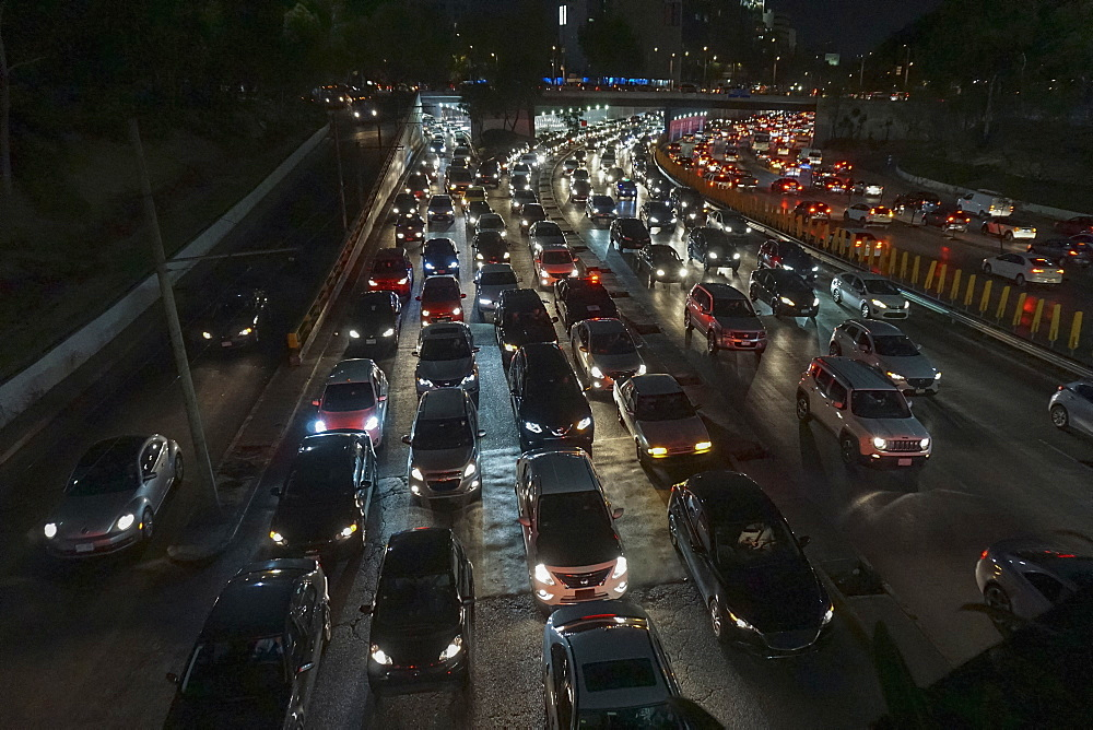 Rush hour traffic on freeway at night, Mexico City, Mexico