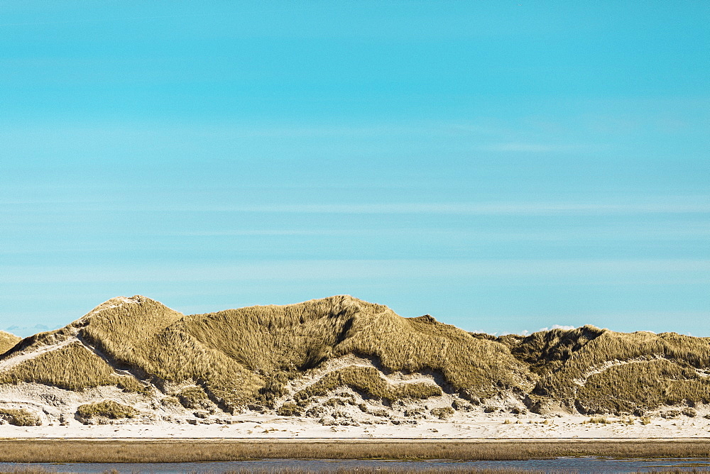 Tranquil sand dunes under sunny blue sky, Norddorf, Schleswig Holstein, Germany