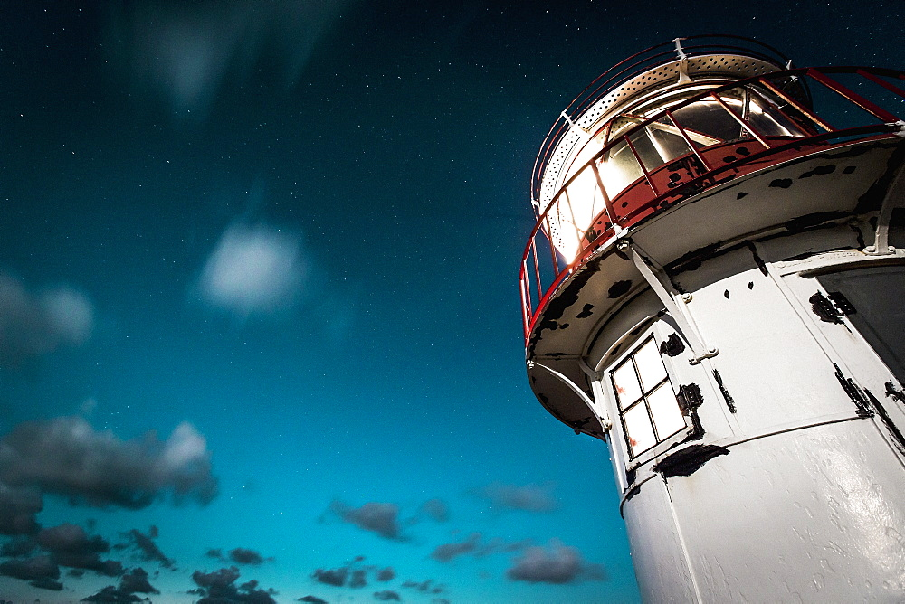 Lighthouse under cloudy night sky, Norddorf, Schleswig Holstein, Germany