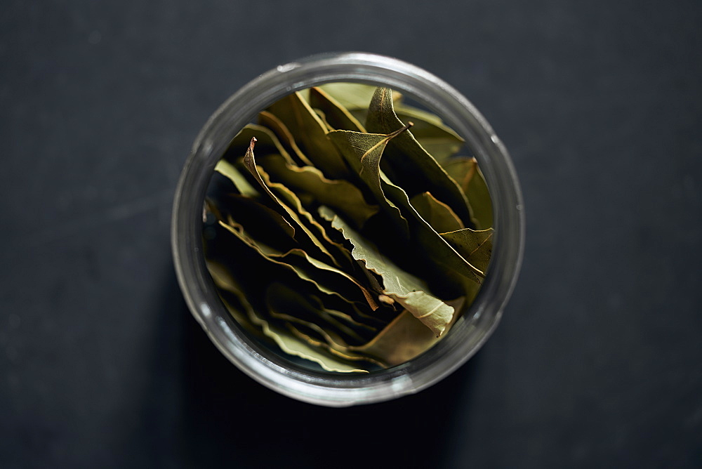 View from above bay leaves in spice jar