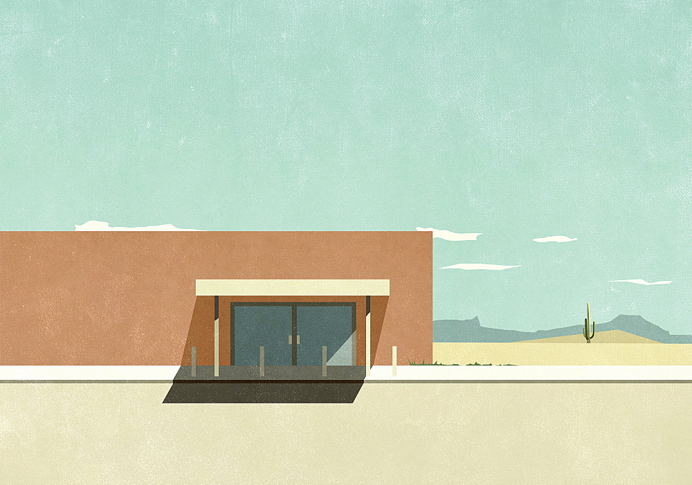 Warehouse building in sunny desert landscape
