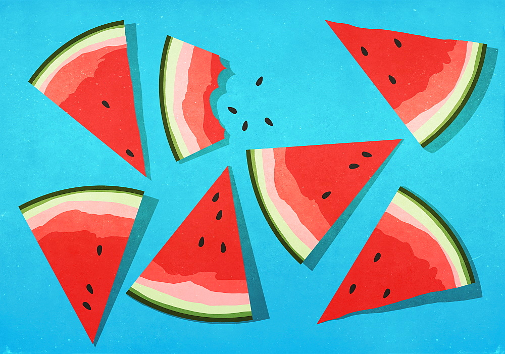 Vibrant watermelon slices on blue background