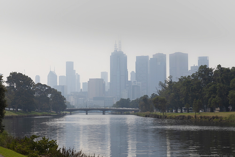 Bush fire haze over Melbourne city and Yarra River, Victoria, Australia