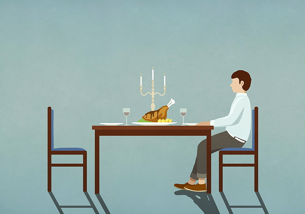Man waiting at table with candlelight dinner