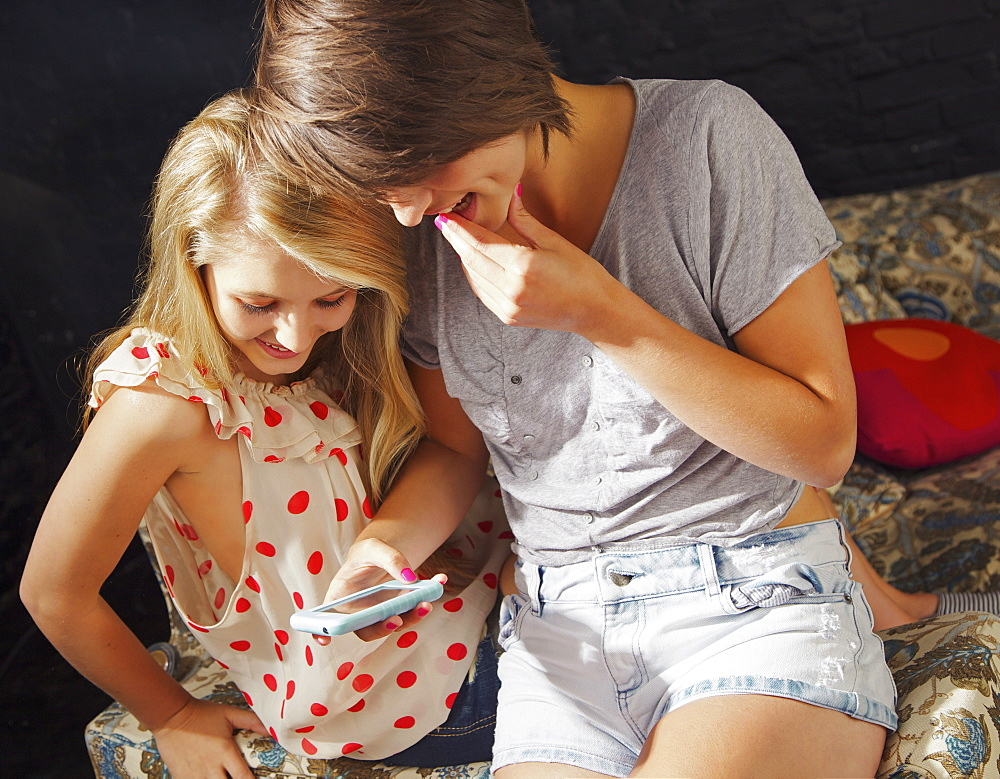 Teenage girls using smart phone