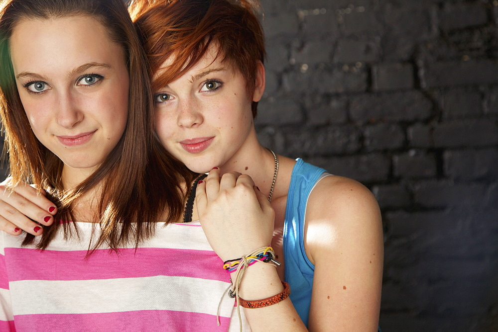 Portrait confident teenage girl friends
