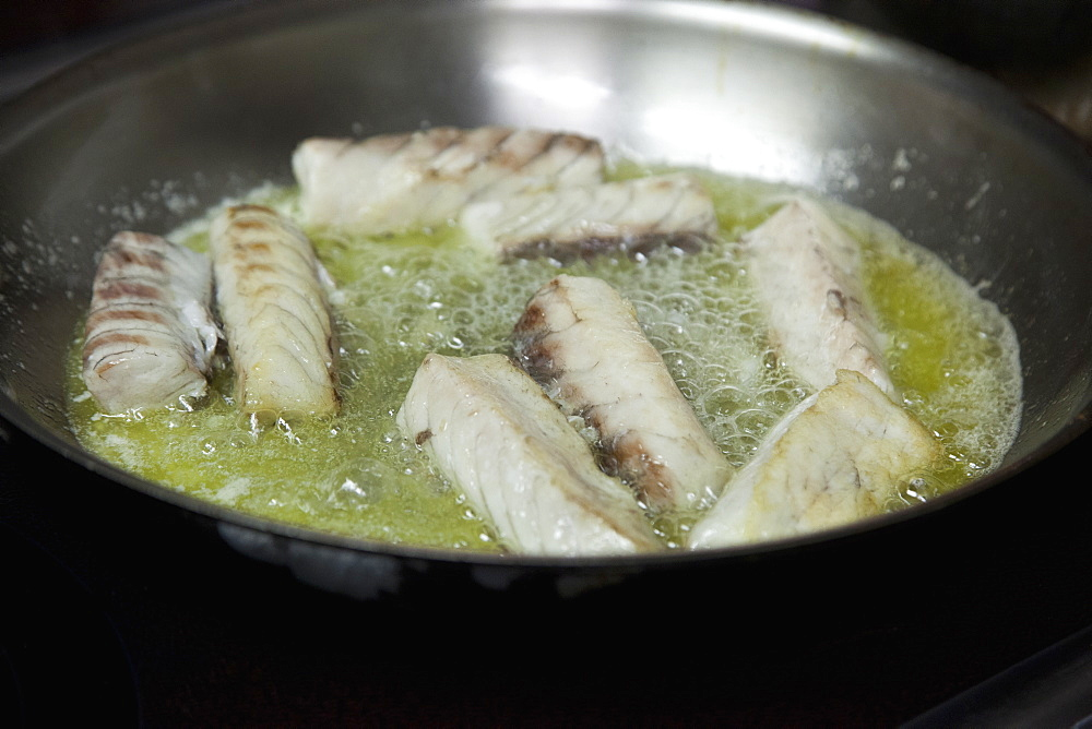Close-up of fish frying in pan