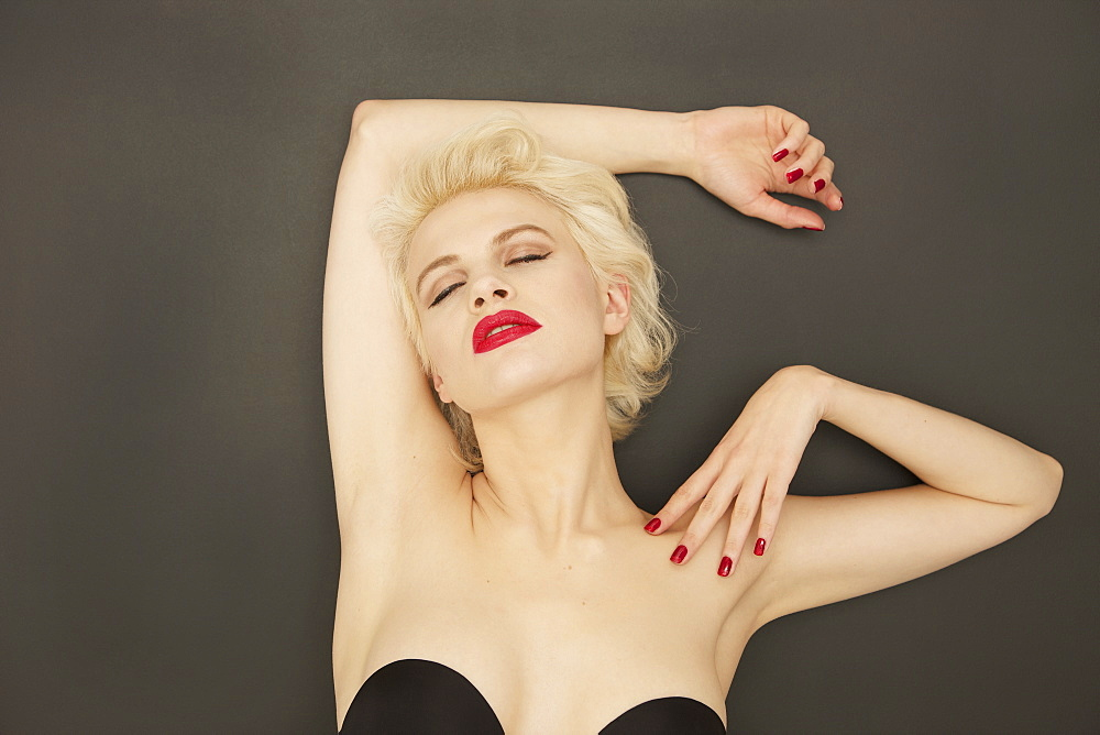 Portrait sensual glamorous young woman with red lipstick