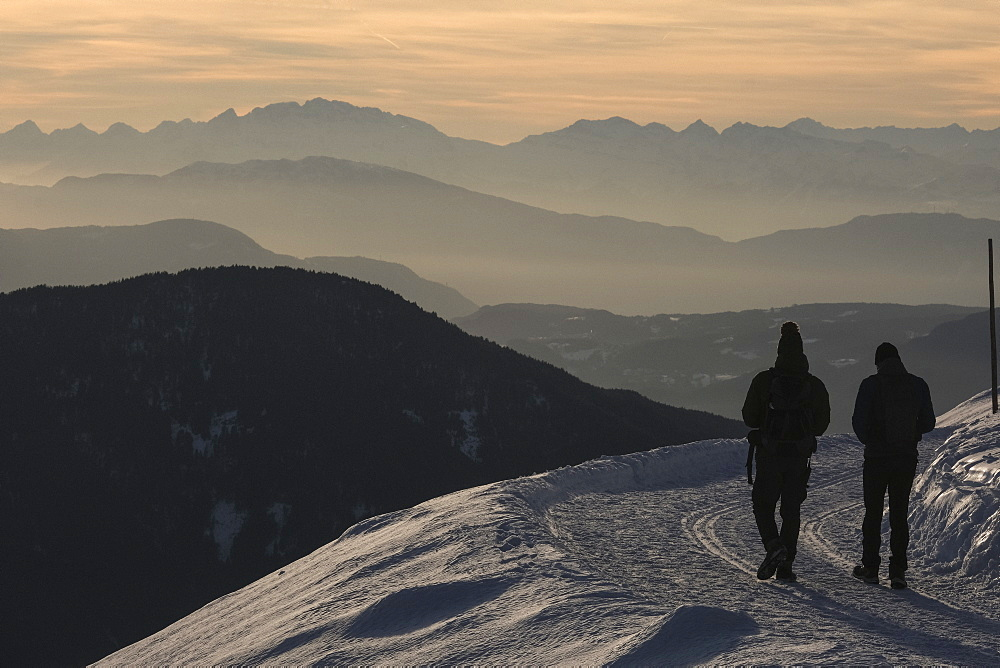 Silhouetted people hiking on snowy mountain, Brixen, South Tyrol, Italy - 1177-3533