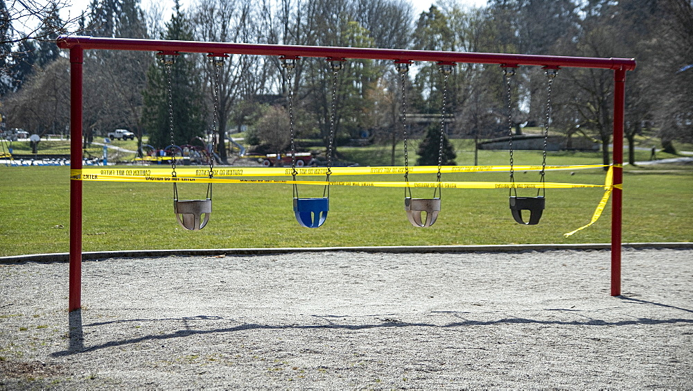 Swing set taped off in playground during COVID-19 pandemic