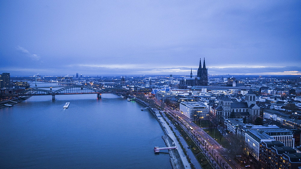 Scenic Rhine River and Cologne cityscape at dusk, Germany