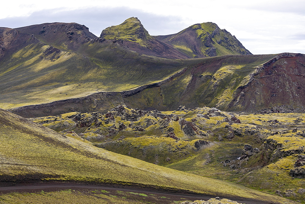 Scenic view moss covered rock formations, Iceland