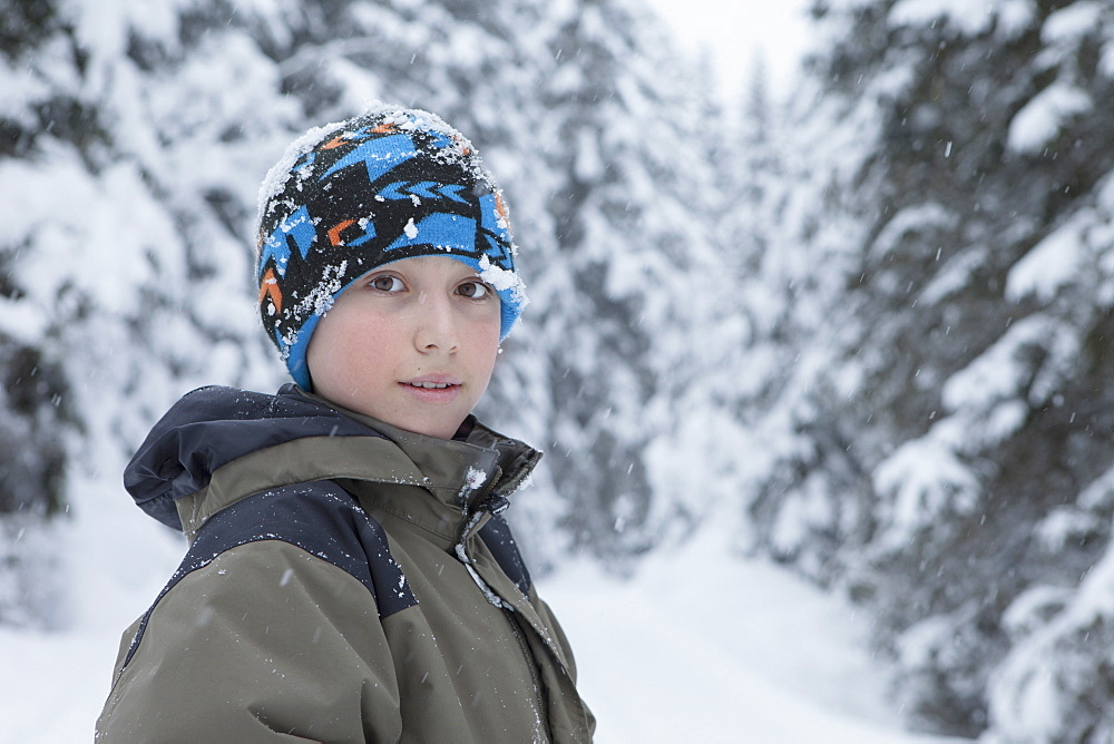 Portrait of confident boy wearing warm clothing during winter