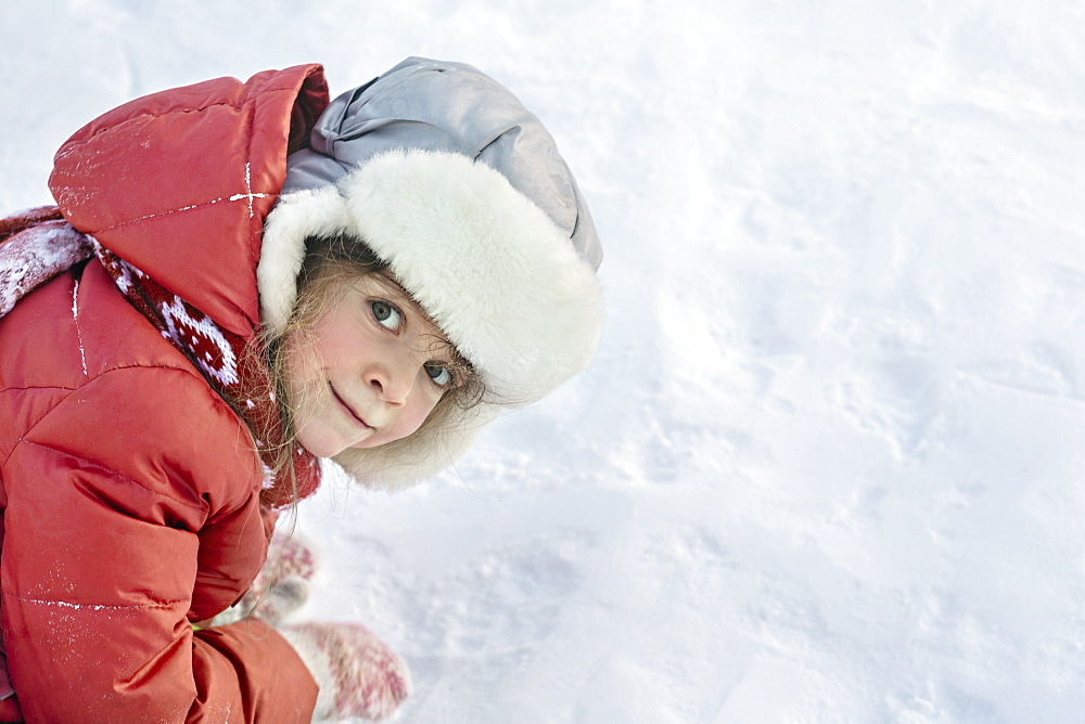 Side view portrait of girl in snow