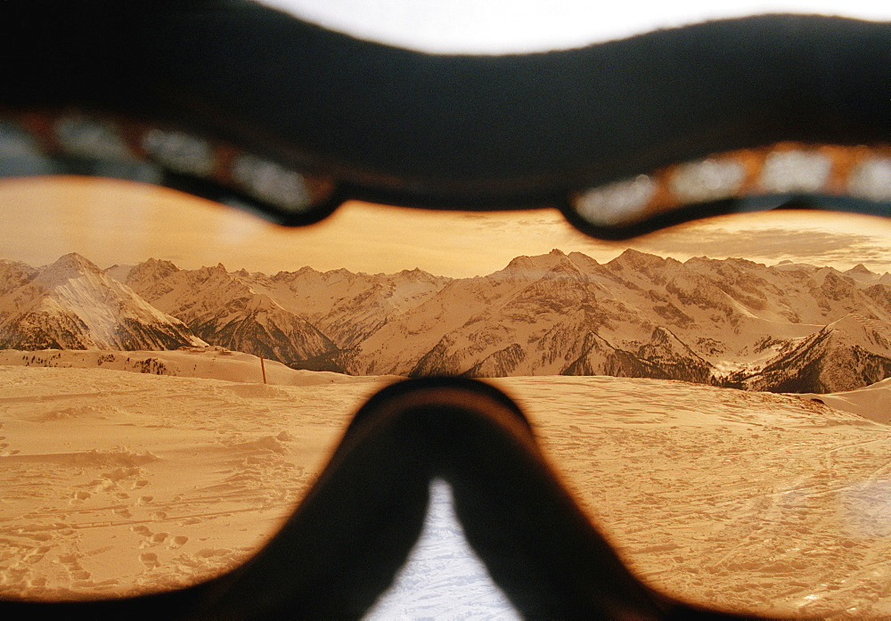 View of a mountain range through a skier's goggles