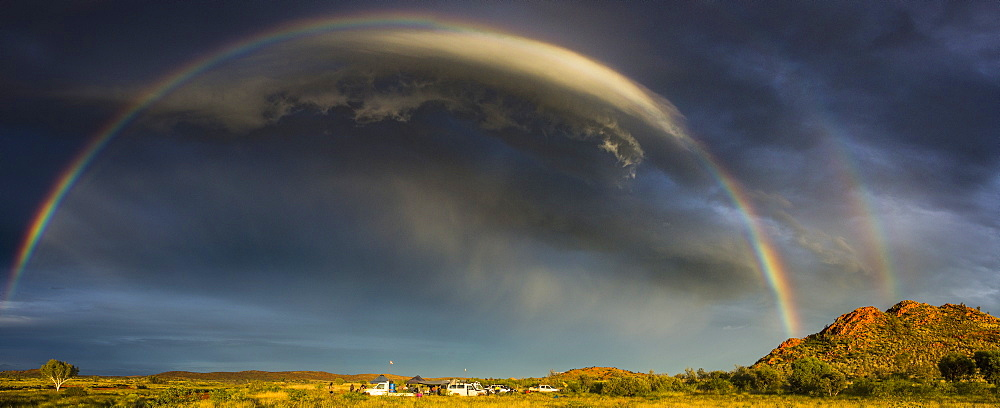 Panoramic view of rainbow over green landscape, Newman, Western Australia, Australia
