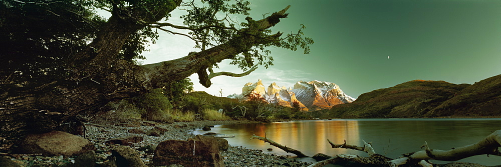 Scenic view of snowcapped mountains against sky from lakeshore at dusk, Torres Del Paine, Patagonia