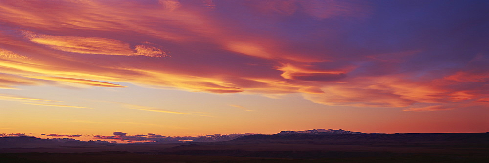 Panoramic view of landscape against orange sky during sunset, Patagonia, Argentina