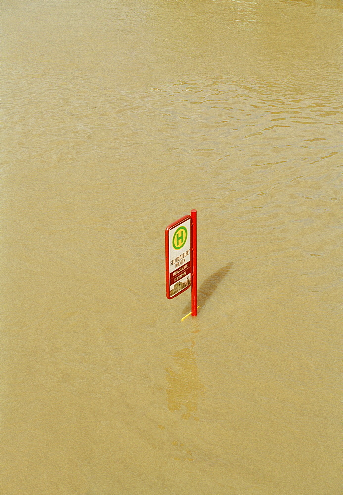 Bus stop underwater during flood