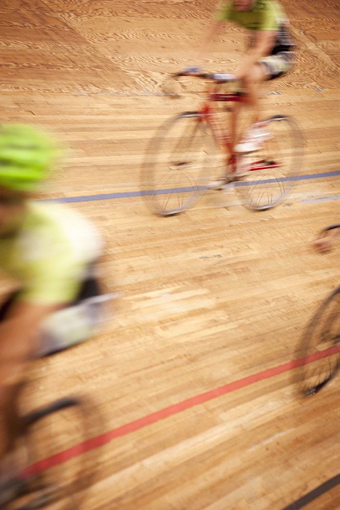 Blurred motion of cyclists racing on track