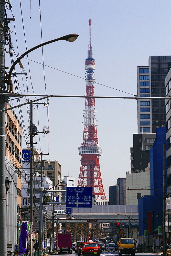 Tokyo Tower seen from city street against clear sky