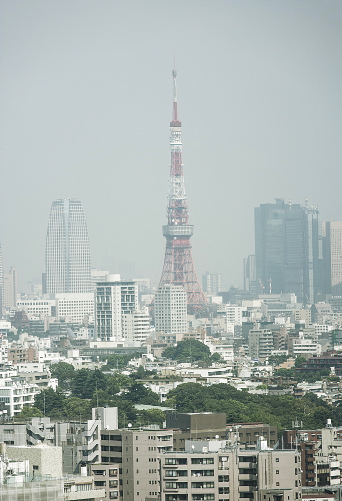 Tokyo Tower and cityscape against clear sky