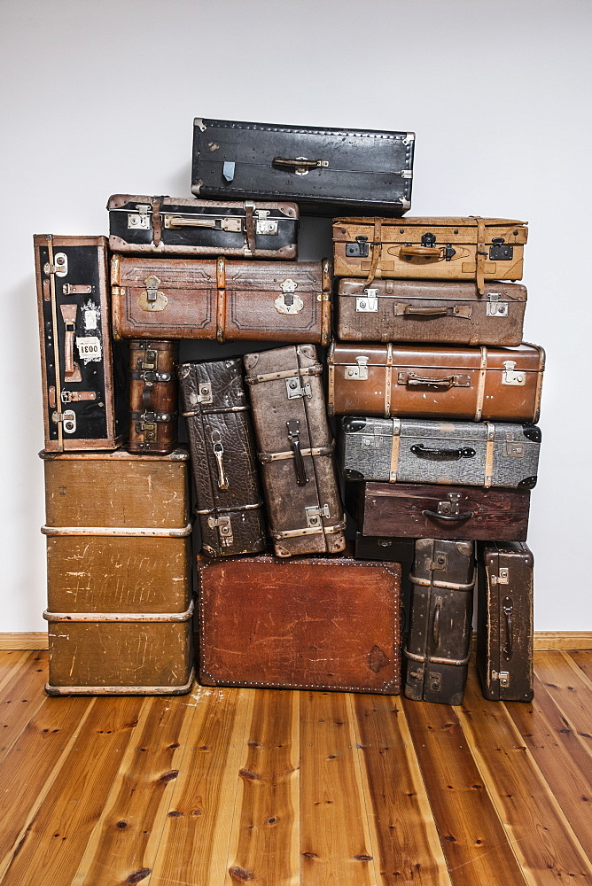 Old suitcases on hardwood floor