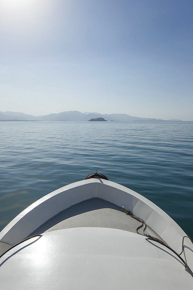 Cropped image of boat on sea against clear sky
