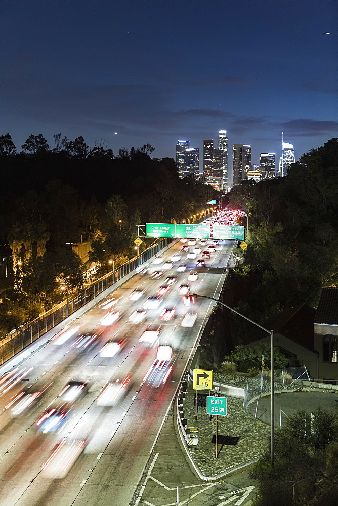 Long exposure cars driving along freeway at night, Los Angeles, California, USA