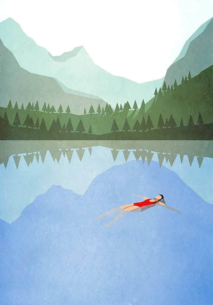 Serene woman floating on back in tranquil mountain lake