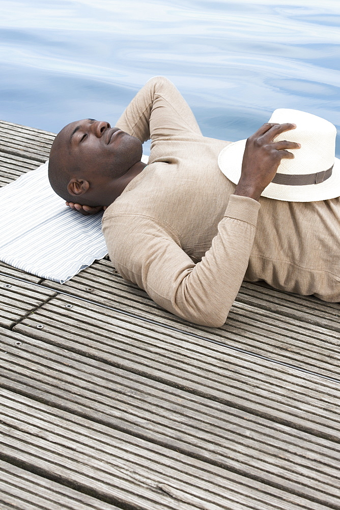 Man relaxing on decking