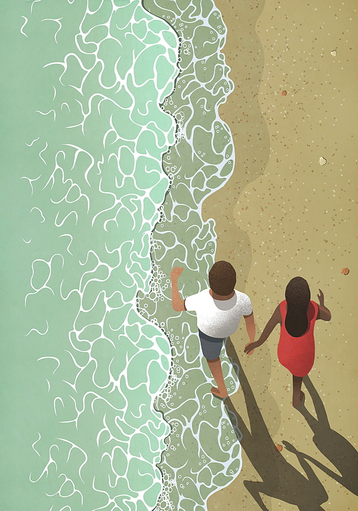 View from above couple holding hands, walking on ocean beach