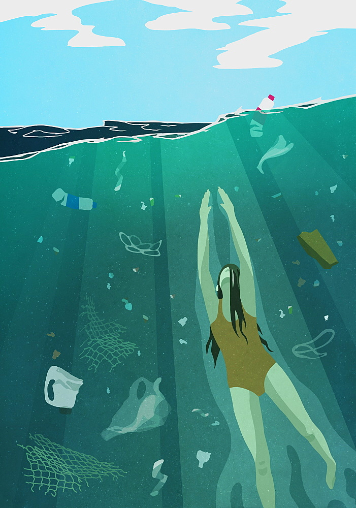 Woman swimming underwater in ocean surrounded by pollution