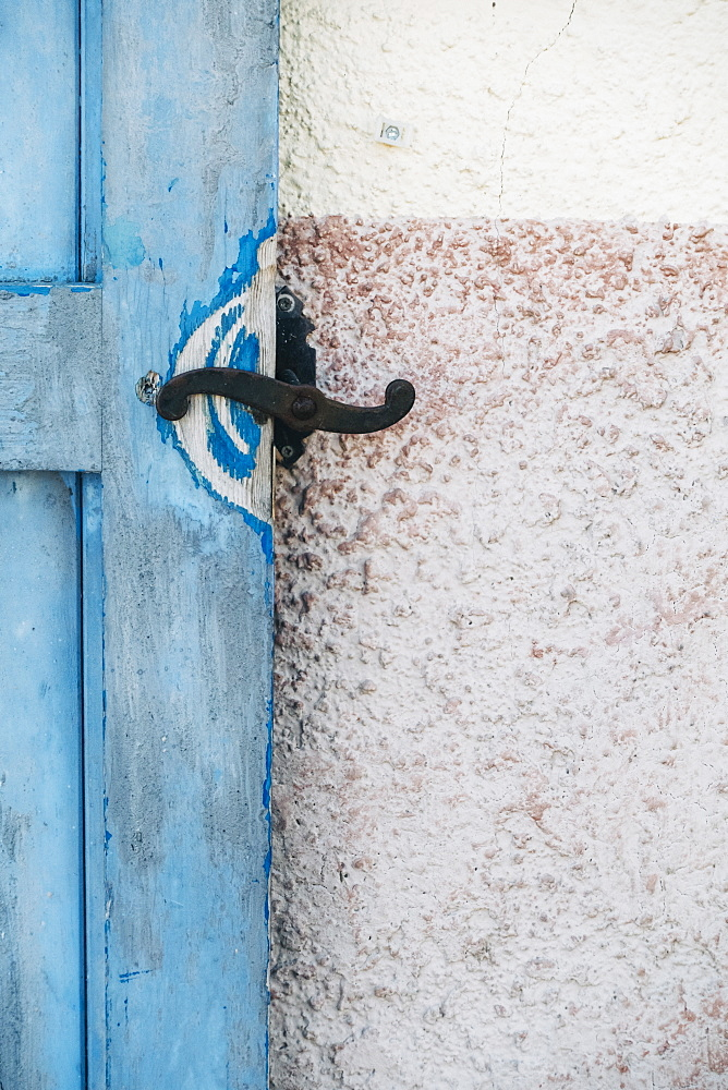Iron latch on blue wooden door
