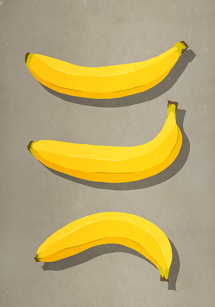 Yellow bananas on brown background