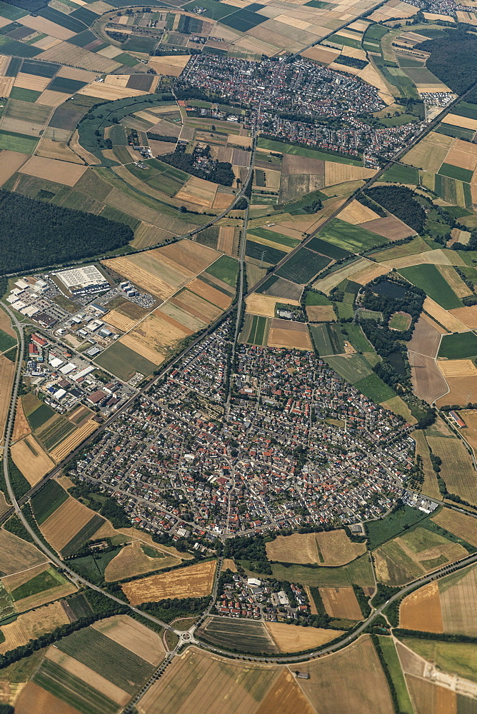 Aerial view city surrounded by rural farmland fields, Frankfurt, Germany