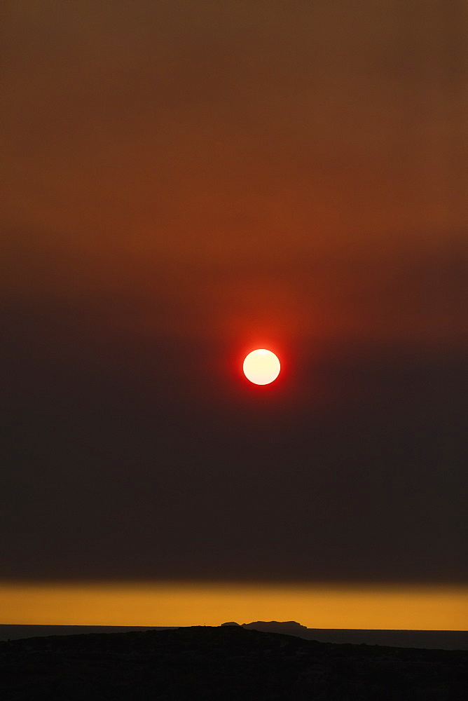 Sun setting in dramatic bush fire sky over York Peninsula, Adelaide, Australia