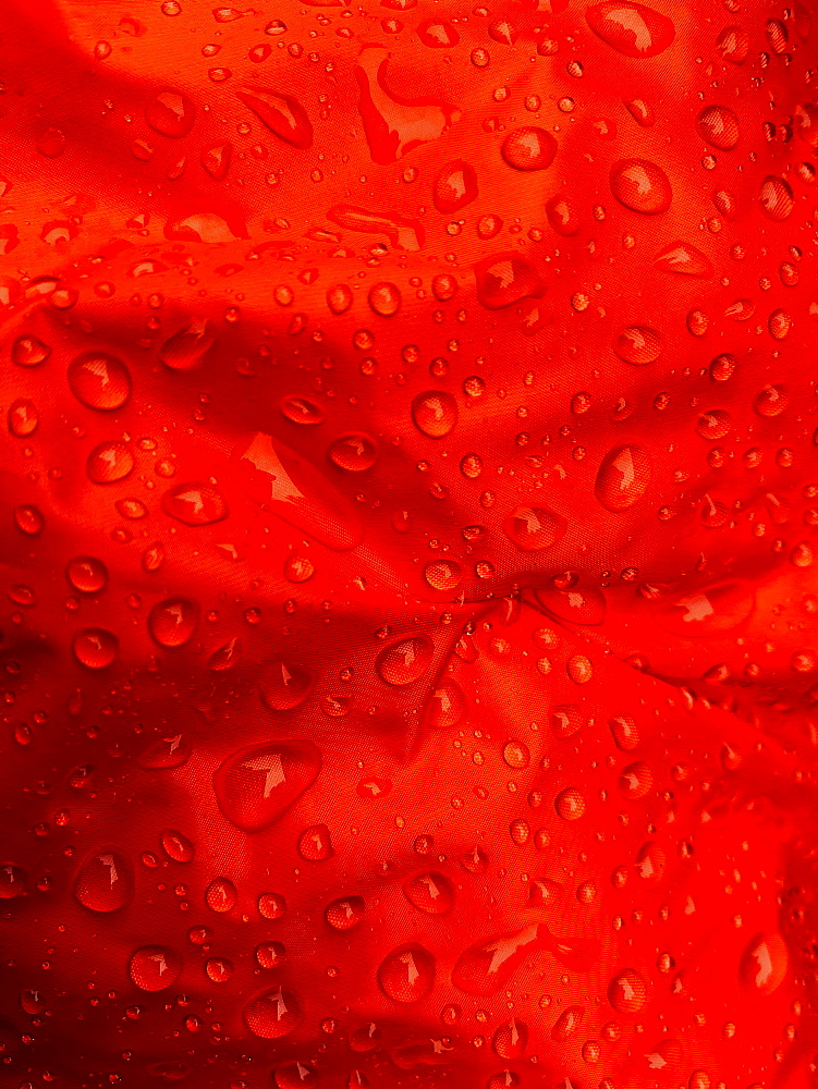 Close up water droplets on red fabric - 1177-3488