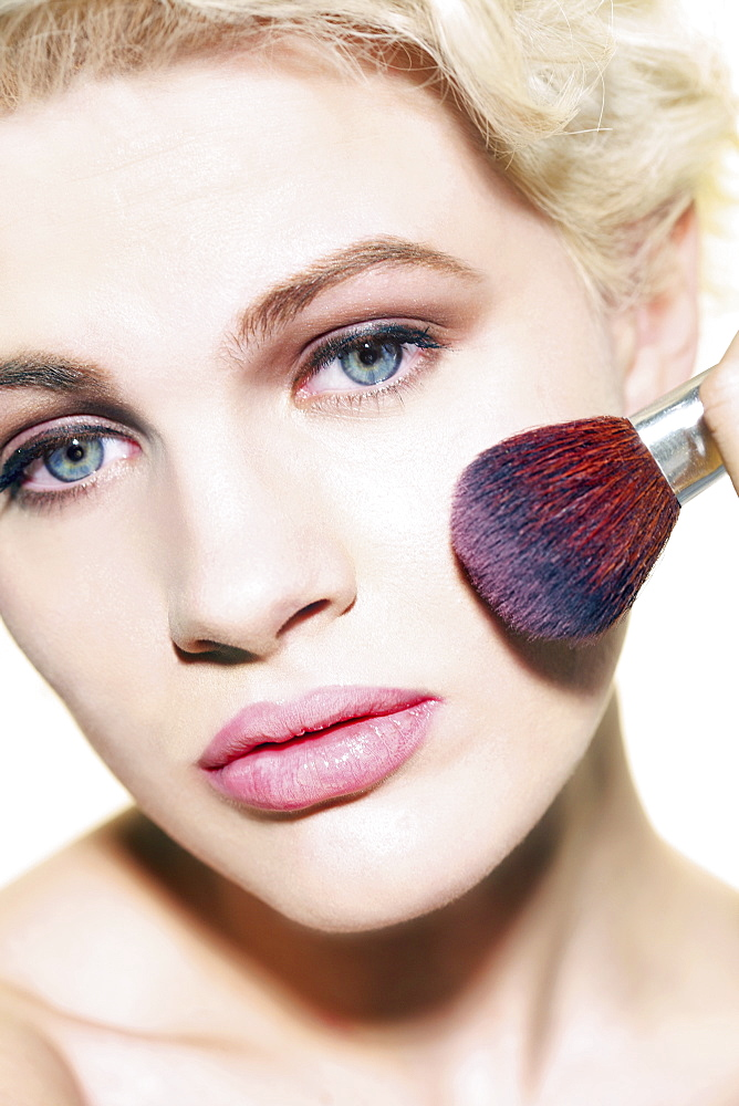Portrait glamourous young woman applying blush with brush - 1177-3490