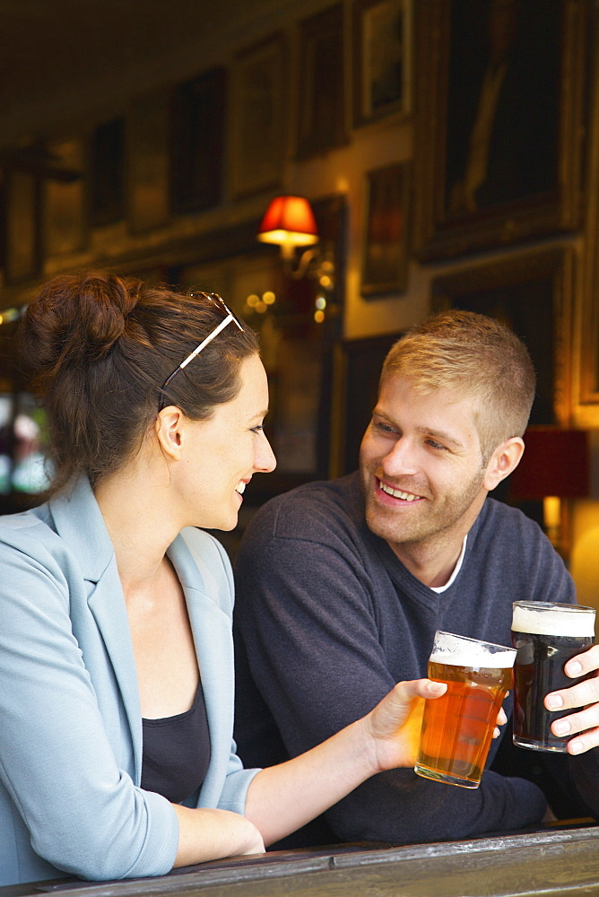 Happy couple drinking beer in pub - 1177-3511