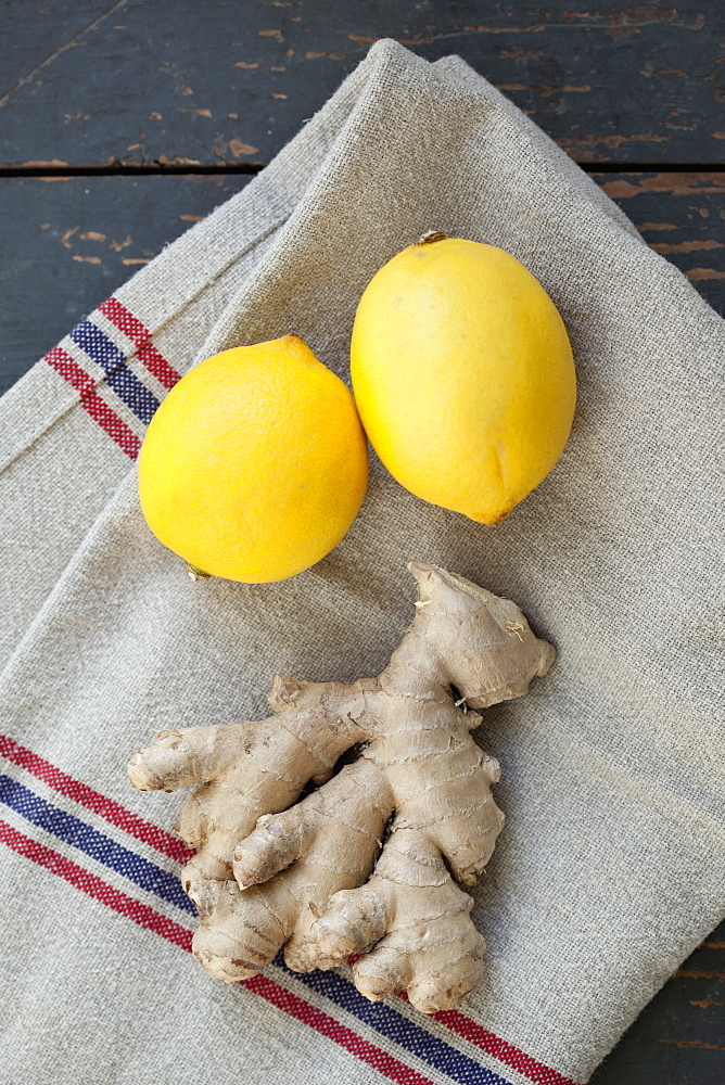 Close-up of lemon and ginger on napkin