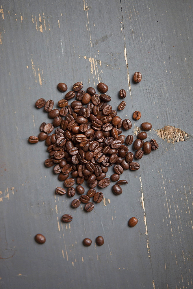 Roasted coffee beans on table