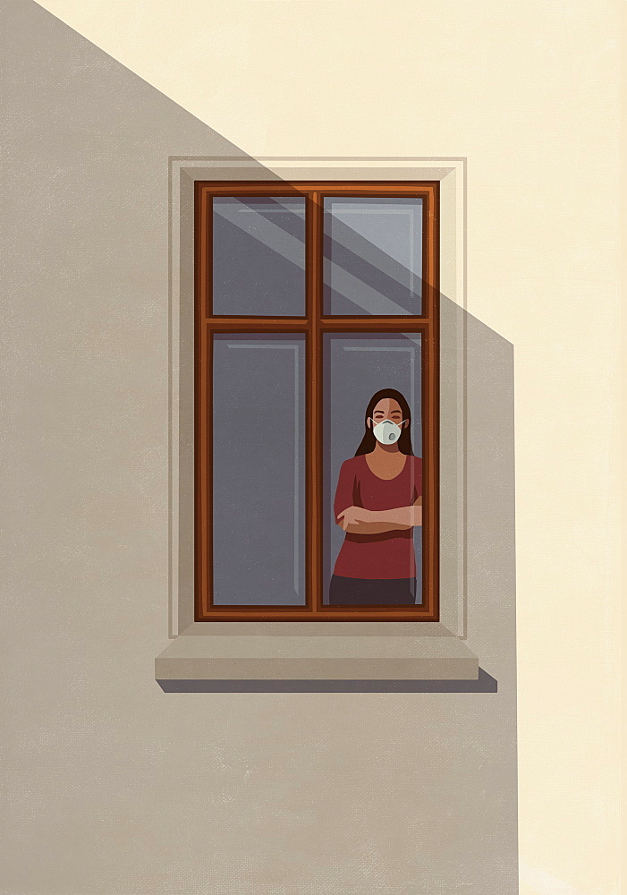 Portrait woman in protective mask standing at apartment window
