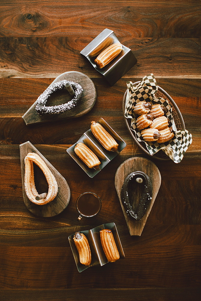 Overhead view of assorted churros on wooden table