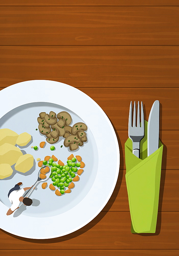 Man spooning vegetables on large plate