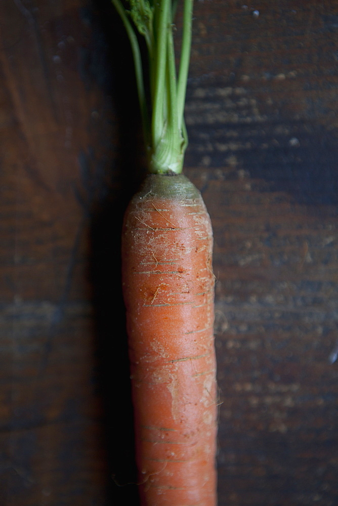 Cropped image of carrot on table