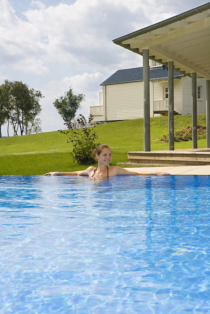 A woman relaxing in a swimming pool