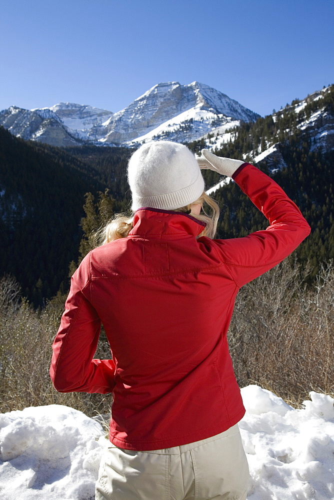 A woman looking at the mountains