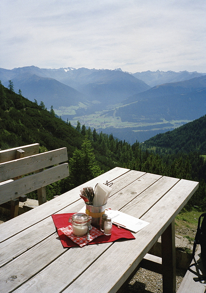 A restaurant terrace overlooking a valley